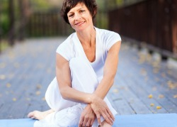 Divorced, middle aged woman relaxing after yoga.