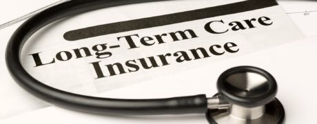 A piece of paper with words Long-term Care Insurance encircled by a stethoscope.