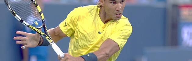 Tennis pro, Rafael Nadal, hits backhand