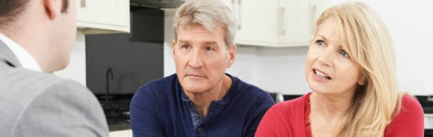 Financial advisor talking to mature couple