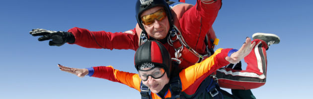 Tandem jump instructor and an older passenger in free fall.
