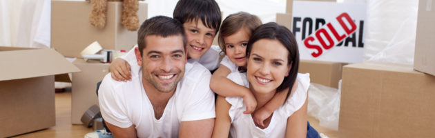 Picture of happy, young family relaxing while moving house